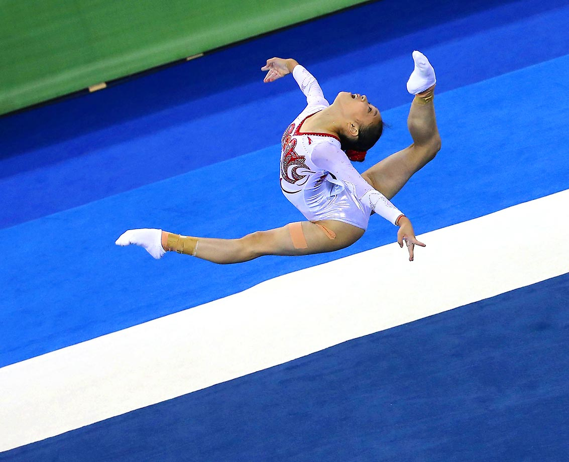 Chinese gymnast Bai Yawen performs in the floor exercise during the qualifying round of the 45th Gymnastics World Championships in Nanning, China.