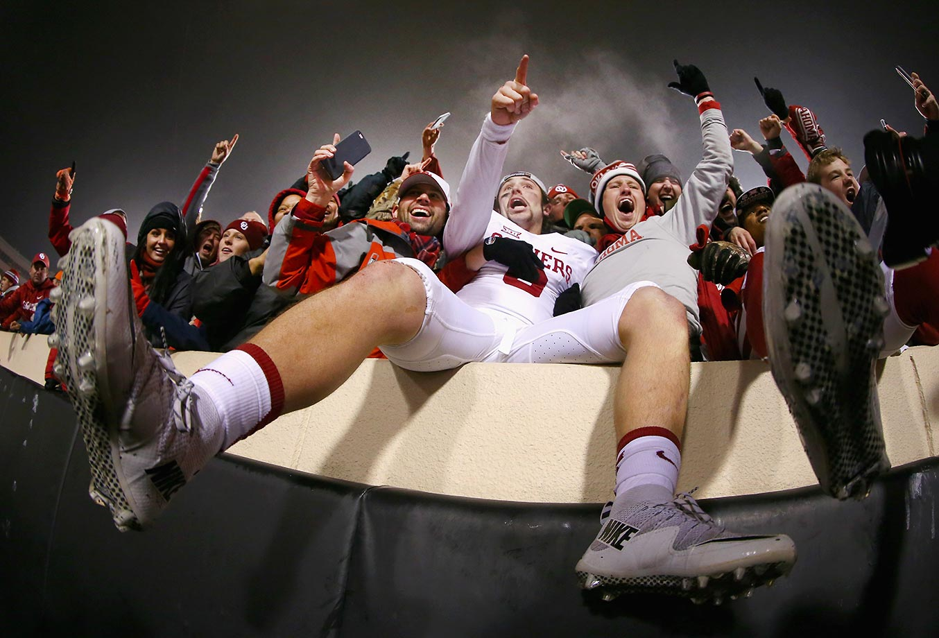 Baker Mayfield of Oklahoma celebrates with fans after beating Oklahoma State 58-23.