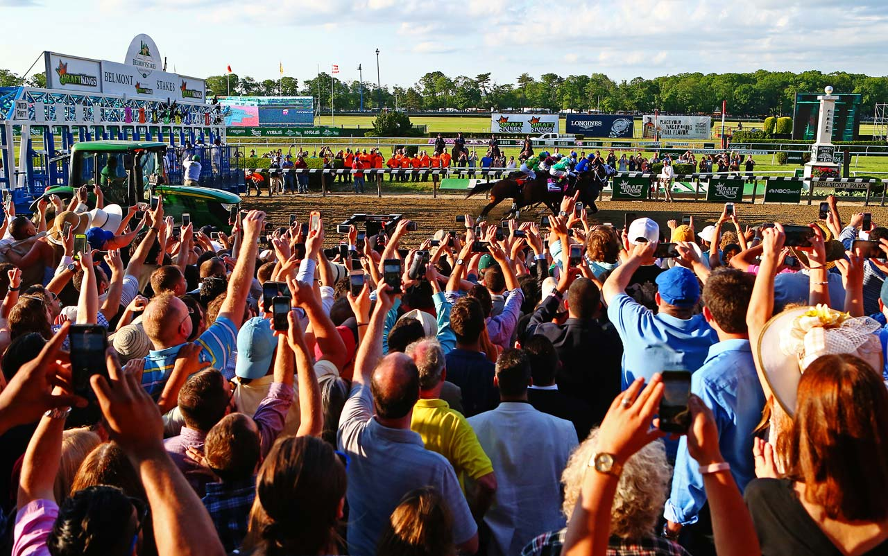 The crowd of 90,000--capped to avoid overcrowding and long lines from last year's total of 102,199--roared for American Pharoah from start to finish. (Text credit: AP)