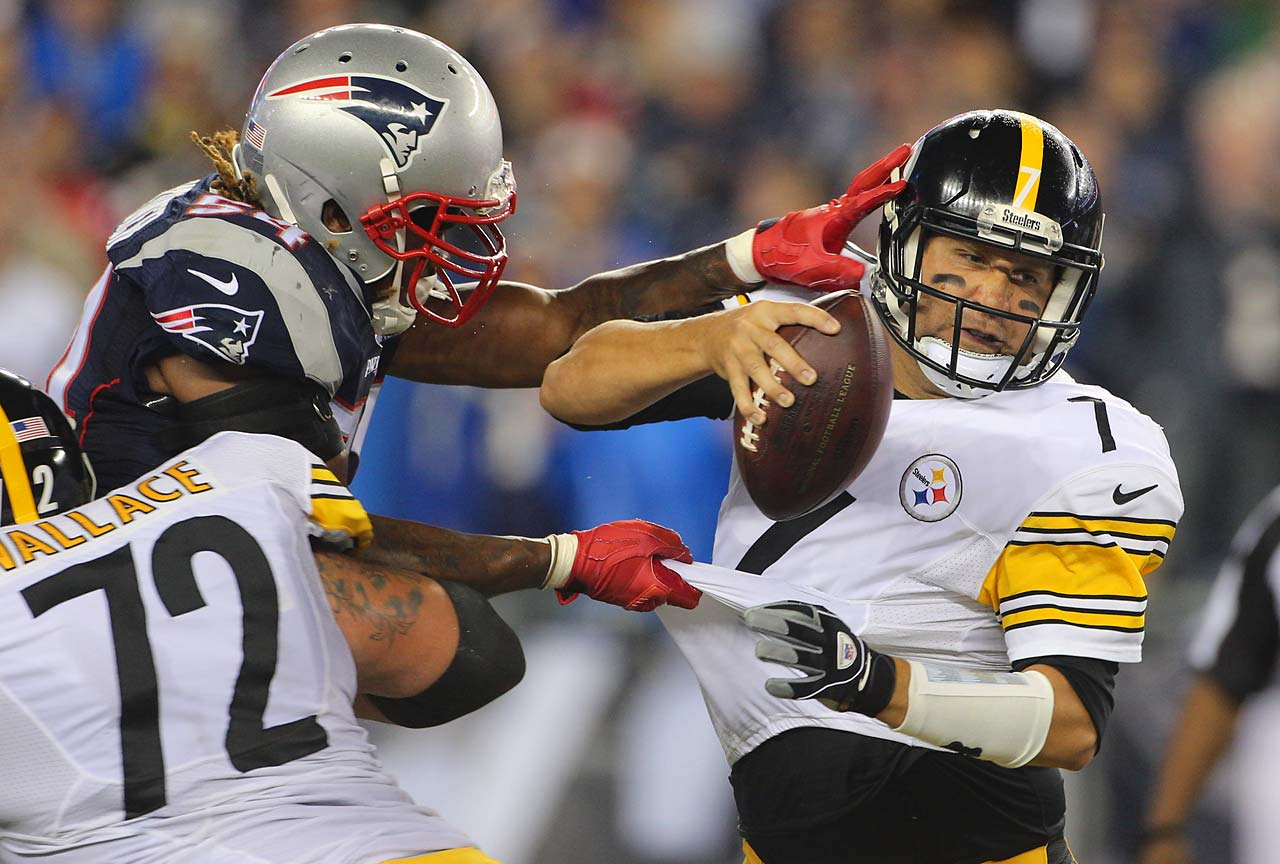 Ben Roethlisberger is pressured by the Patriots in an opening-week loss.
