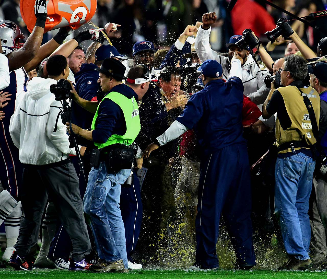 New England coach Bill Belichick gets a Gatorade bath.