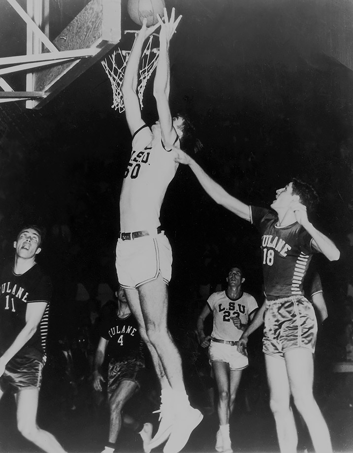 Cut from his high school's varsity team as a freshman and sophomore, Pettit was forced to develop his game on his own in his backyard. After becoming a starter as a junior, Pettit earned his way to LSU, where he led the SEC in scoring each of his three years on the varsity. Pettit was among the greatest basketball players in LSU history and ranks first in career rebounding average and third in scoring average. He led LSU to back-to-back SEC championships in 1953 and 1954. LSU reached the 1953 Final Four before losing to Indiana despite 29 points and 15 rebounds from Pettit. The Tigers returned to the Sweet 16 the next year.