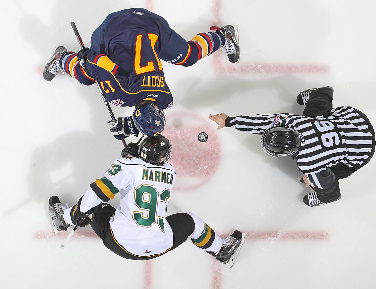Brendan Lemieux of the Barrie Colts faces off against Mitchell Marner of the London Knights in an OHL game. Barrie defeated London 4-3.