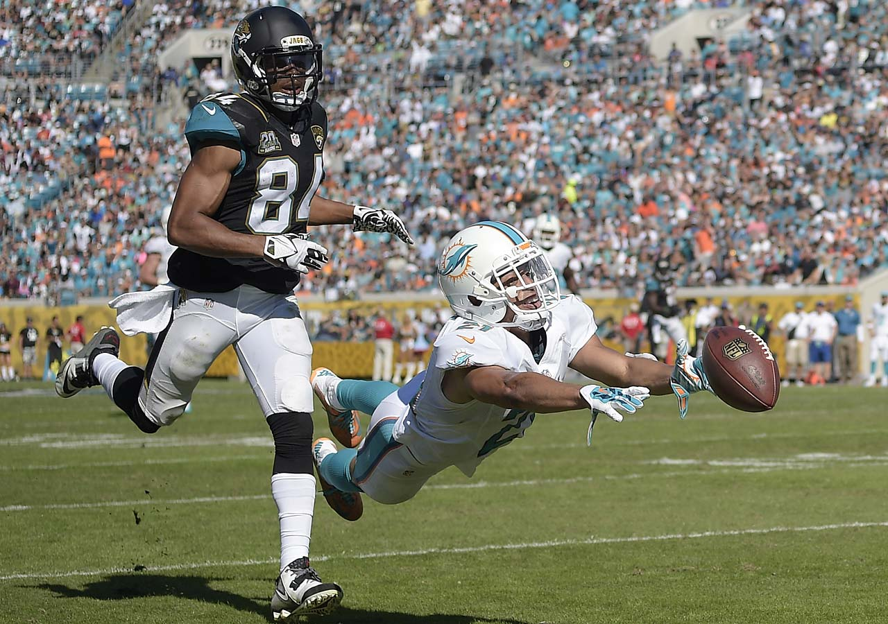 Brent Grimes dives in an attempt to intercept this pass against Jacksonville.