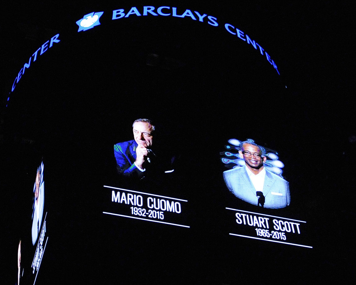 Former New York Governor Mario Cuomo and ESPN anchor Stuart Scott are both honored with a moment of silence before the Brooklyn Nets game against the Dallas Mavericks at Barclays Center on Jan. 5, 2015 in Brooklyn, N.Y.
