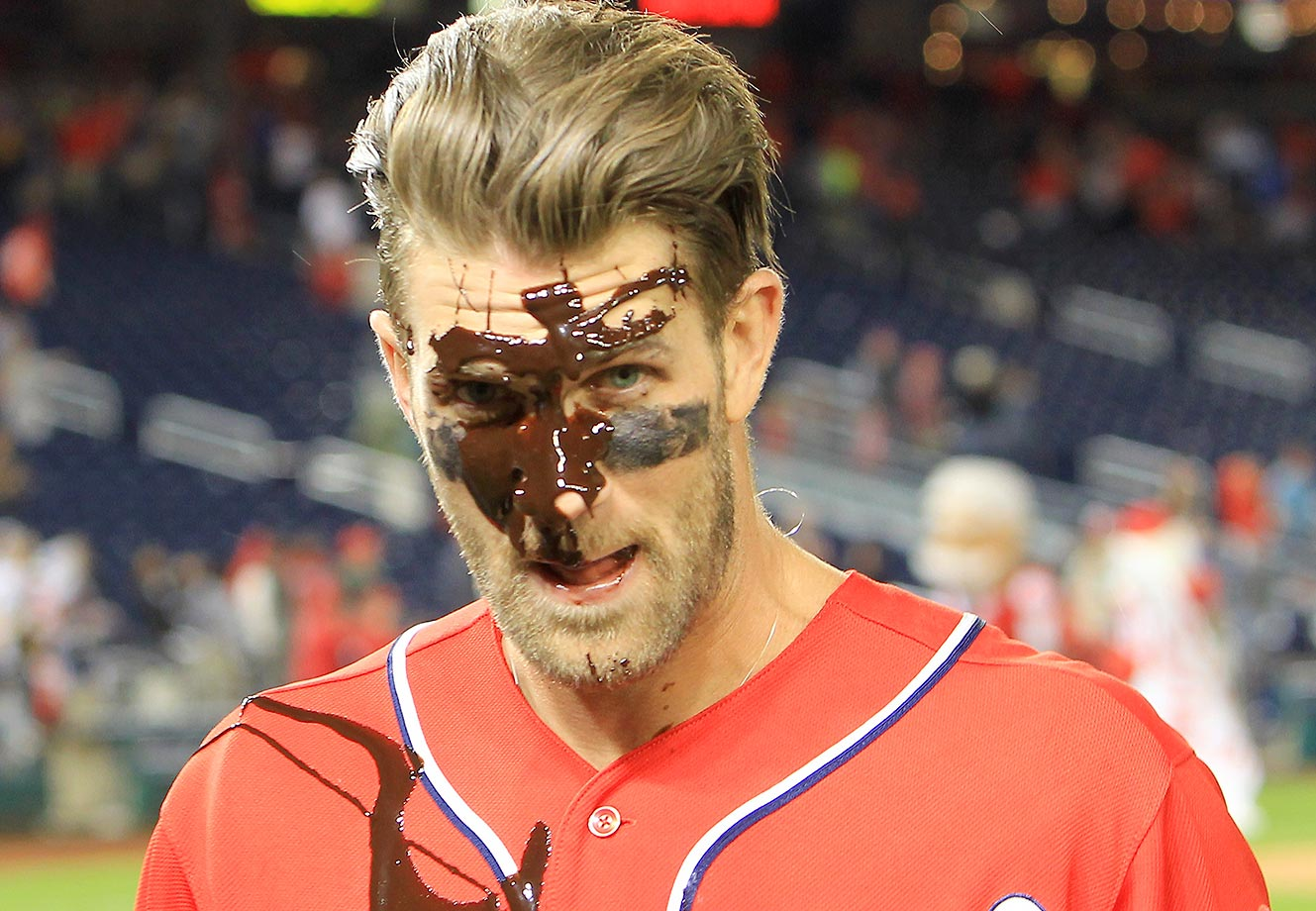Bryce Harper of the Washington Nationals gets the chocolate syrup treatment after his walk-off double win over the Phillies.