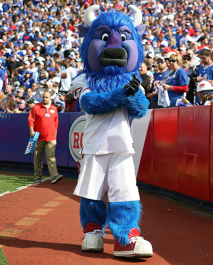 "He's big, he's blue, he was probably the easiest mascot to name in mascot history. We're just happy they didn't go off script and name him ""Harvey de Bison"" or something similarly odd. He looks like Beast, from ""Beauty and the Beast,"" so he's able to pull off the tough guy look, while still being kid-friendly – like the wrestler, Mankind!"