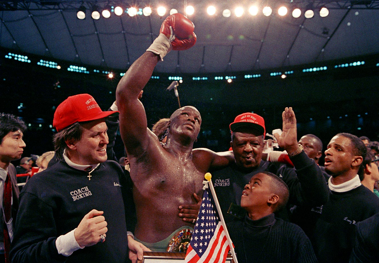 Not the same as the old boss. With his manager, John Johnson, beside him, Douglas—the pride of Columbus, Ohio, and the new heavyweight champion of the world—waved in joy, and perhaps disbelief, to the cheering crowd.