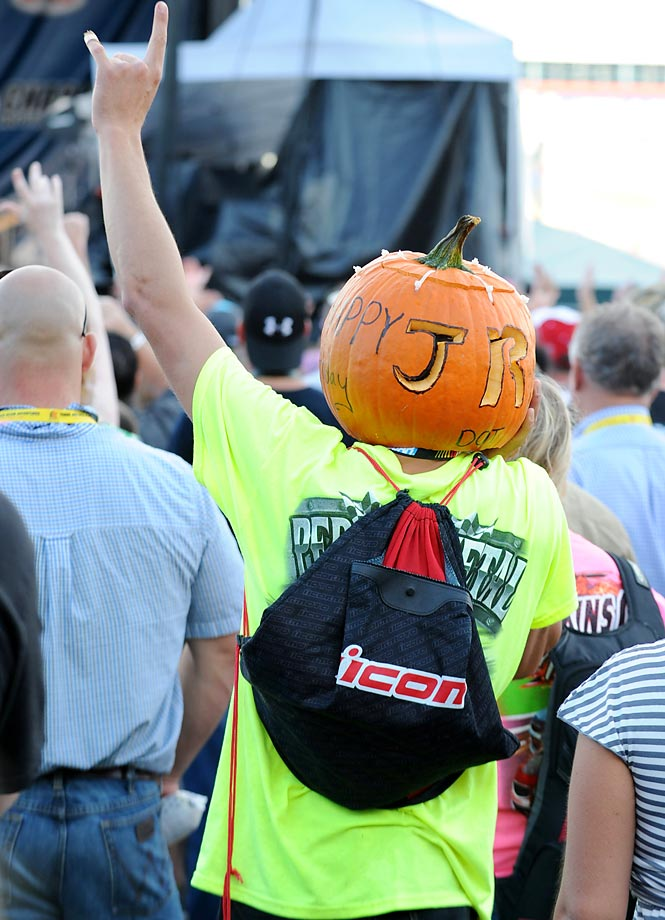 A Dale Earnhardt Jr. fan watchs the band Perry on stage before the race in North Carolina.