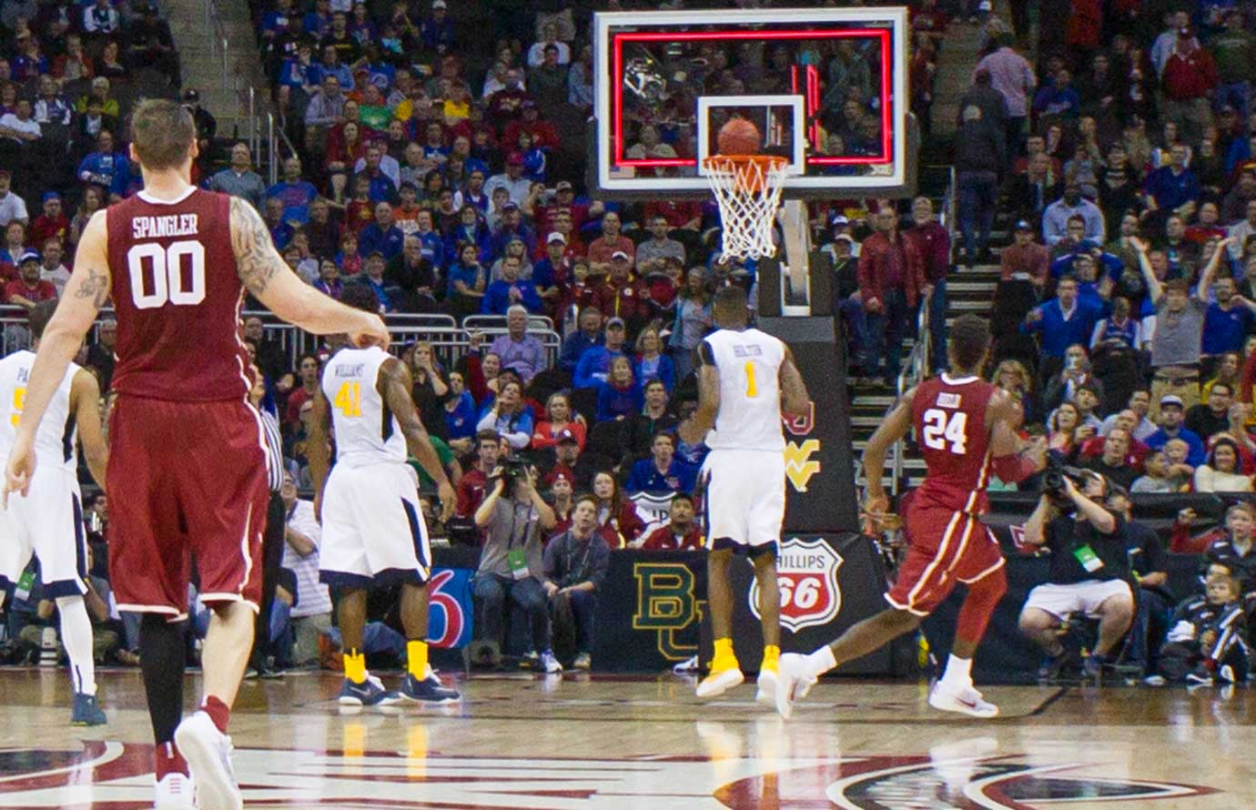 Oklahoma's Buddy Hield (24) watches his 55-foot three-point shot go in for what would have been a 70-69 victory for the Sooners, but officials later ruled the ball hadn't left his hand before time expired.