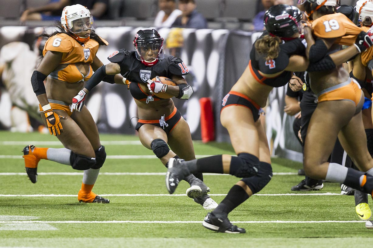 Atlanta Steam running back Nas Johnson rumbles for two yards and cloud of lingerie against the Crush at Toledo's Huntington Center.