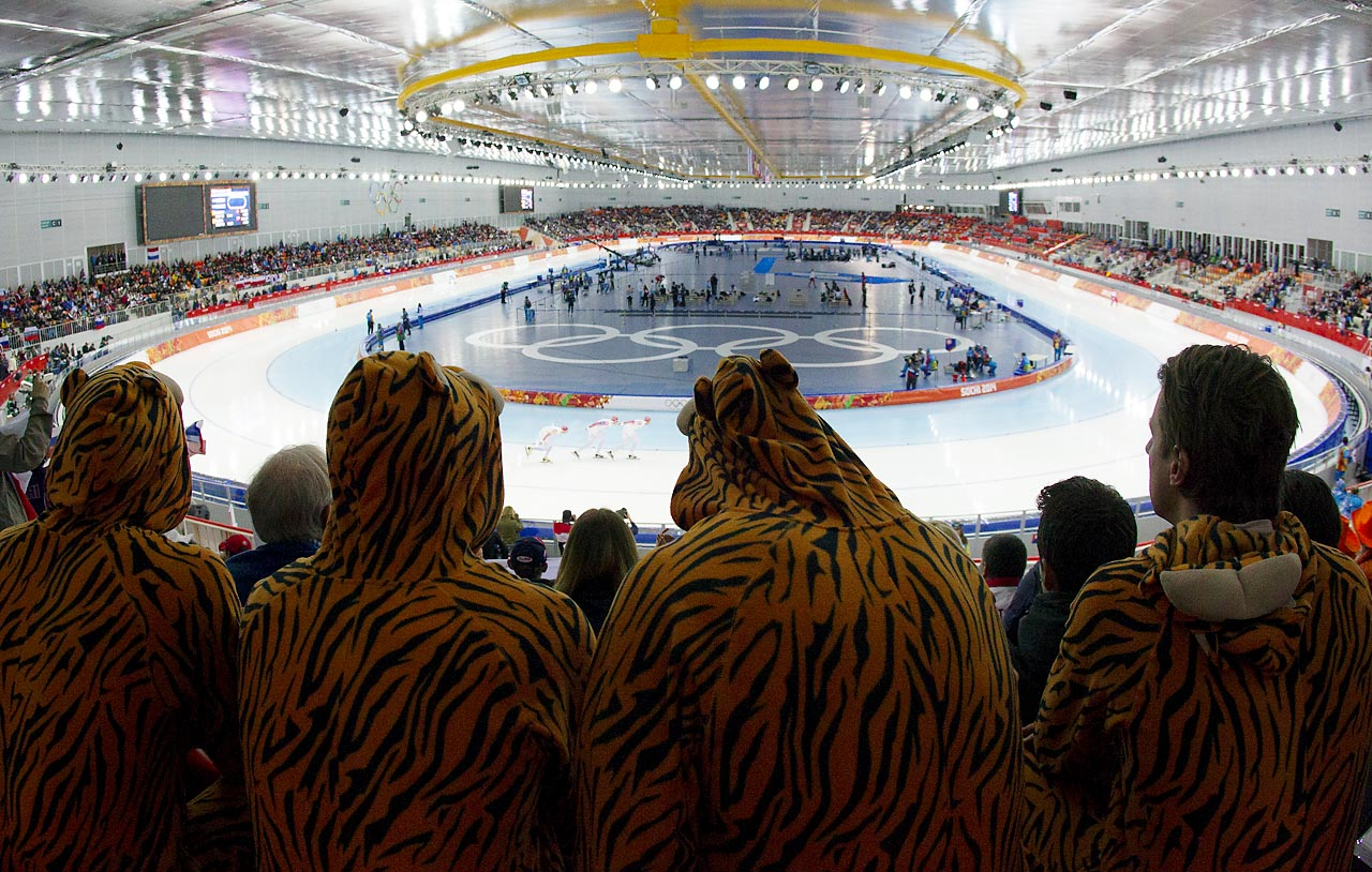 Fans in costume watching the Men's Team Pursuit Final.