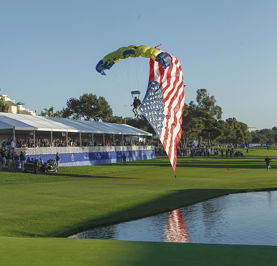 Sky divers deliver the trophy and American flag to the awards ceremony on the Torrey Pines Golf Course during the final round of the Farmers Insurance Open.