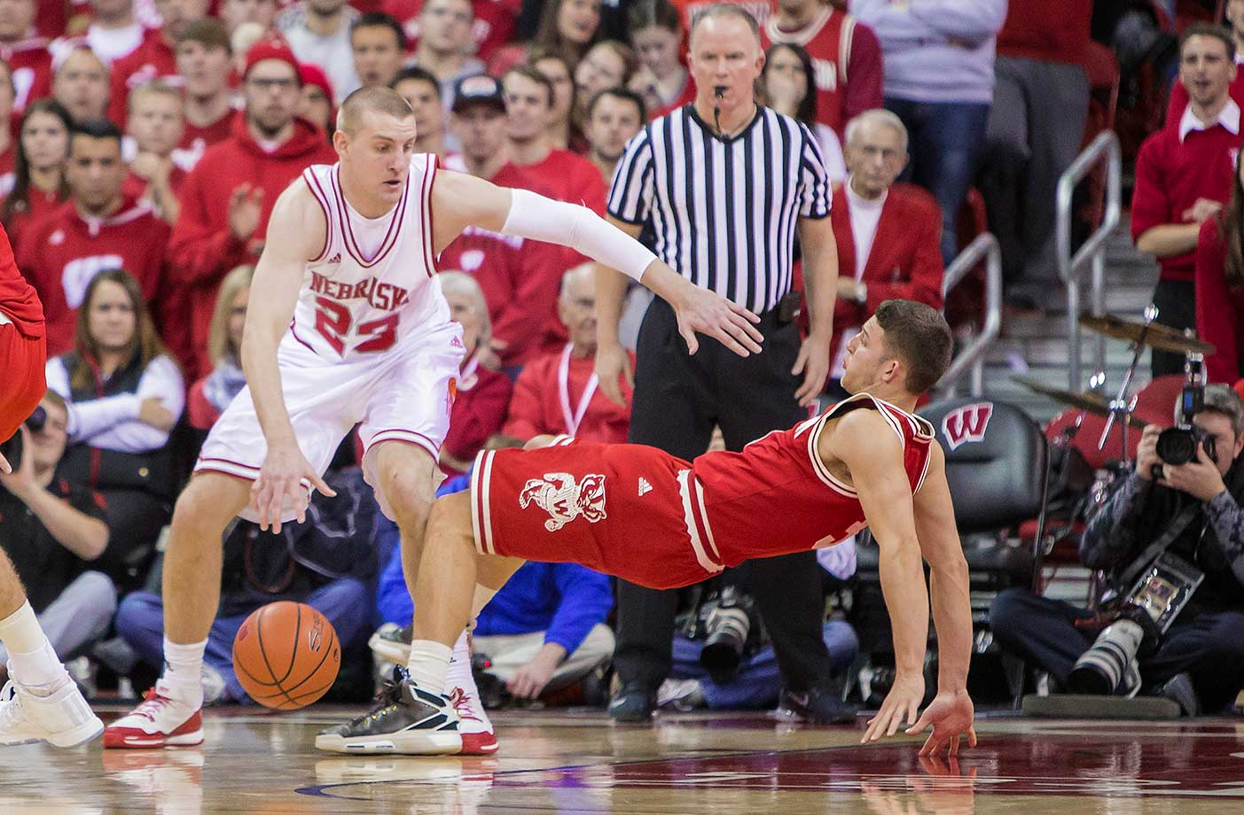 Wisconsin guard Zak Showalter draws the charge call against Nebraska forward Nick Fuller.
