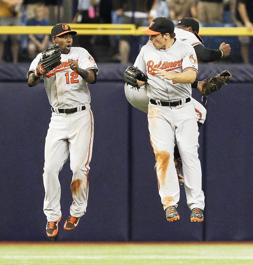 Alejandro De Aza and Travis Snider of the Orioles celebrate their win against the Rays.