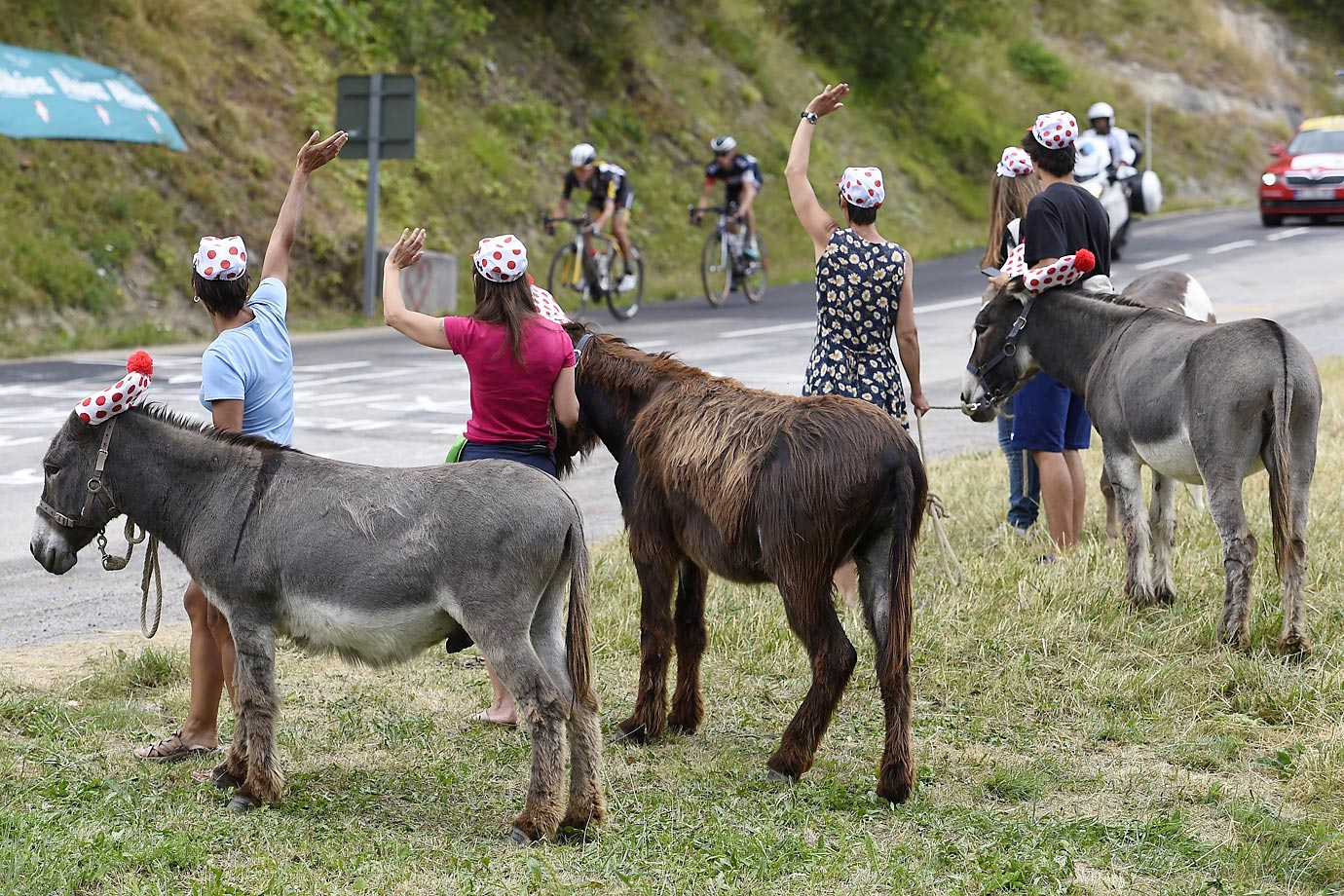 An interesting group of fans watch stage 19 of the Tour de France.