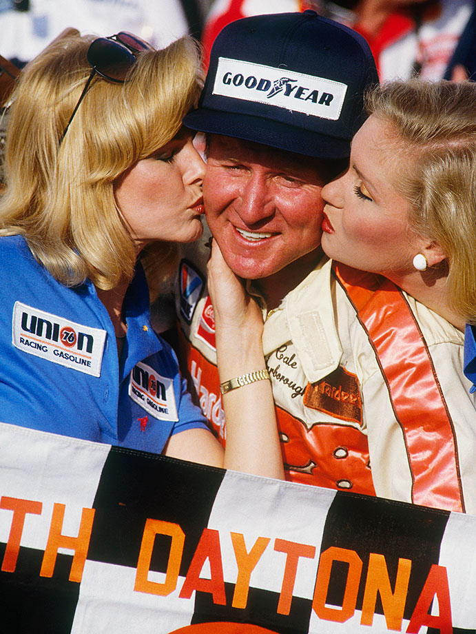 Cale Yarborough goes on to take the trophy despite crashing his car during qualifying and having to utilize a back-up car in the race itself. Yarborough is one of only two drivers in NASCAR history to win three consecutive championships.