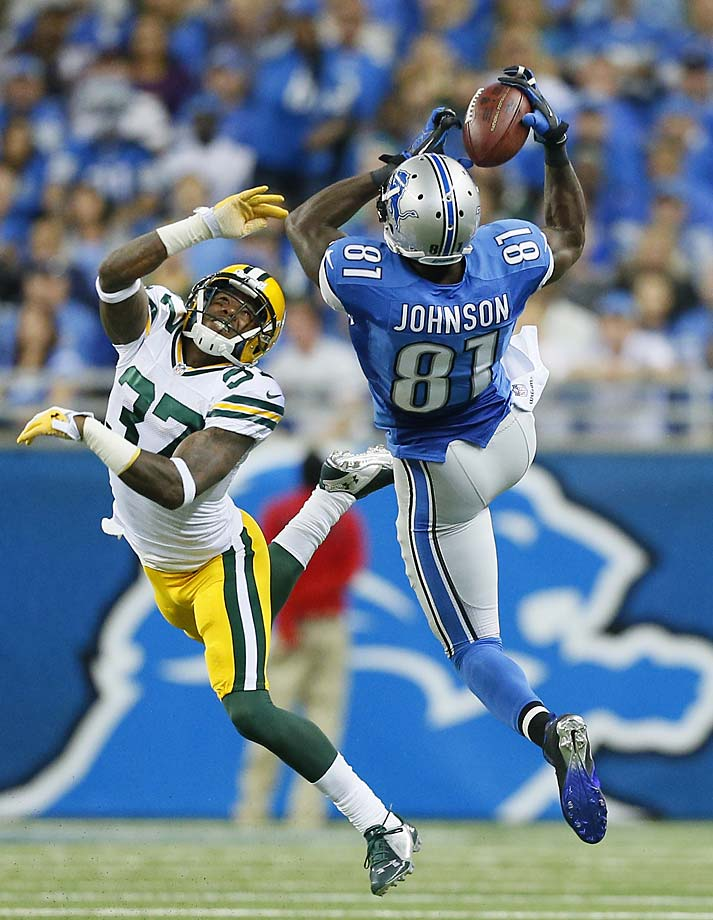 Calvin Johnson is defended by Green Bay Packers cornerback Sam Shields while making this catch during the Lions victory.