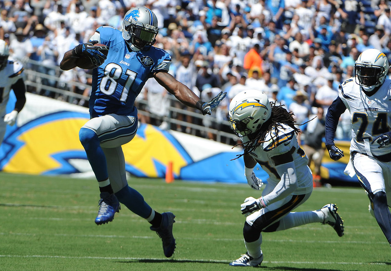 Detroit wideout Calvin Johnson tries to get around San Diego Chargers safety Jahleel Addae.