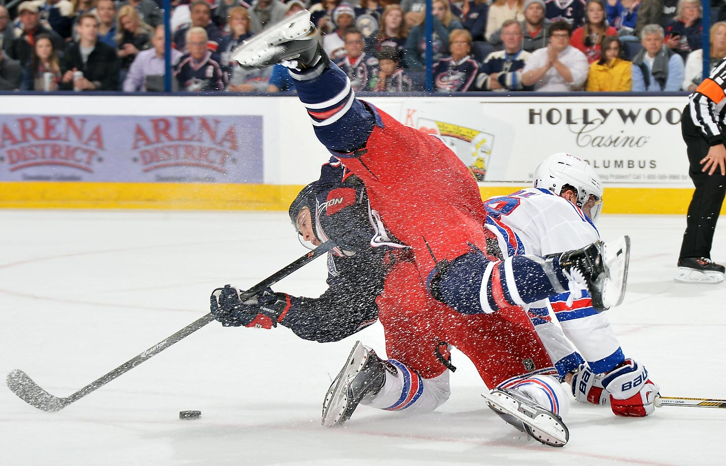 Cam Atkinson of the Columbus Blue Jackets is knocked off his feet by Marc Staal of the New York Rangers. Columbus defeated New York 5-2.