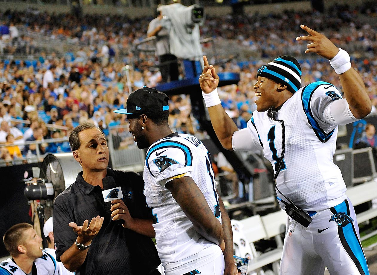 Cam Newton of the Carolina Panthers photobombs Brandon LaFell.