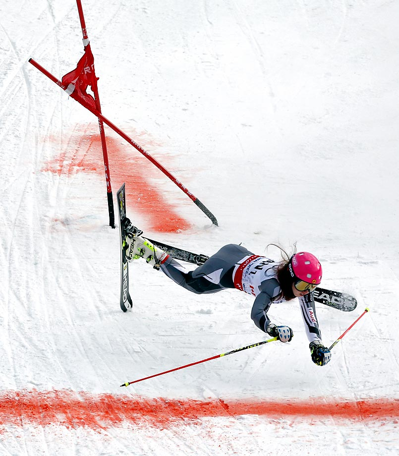 Canada's Candace Crawford wipes out during the mixed worlds team skiing event in Vail, Colo.