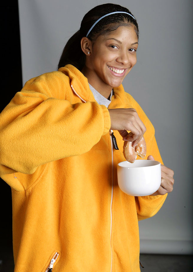 Tennessee forward Candace Parker poses, dipping a doughnut in a coffee mug on Jan. 23, 2007 in Knoxville, Tenn.
