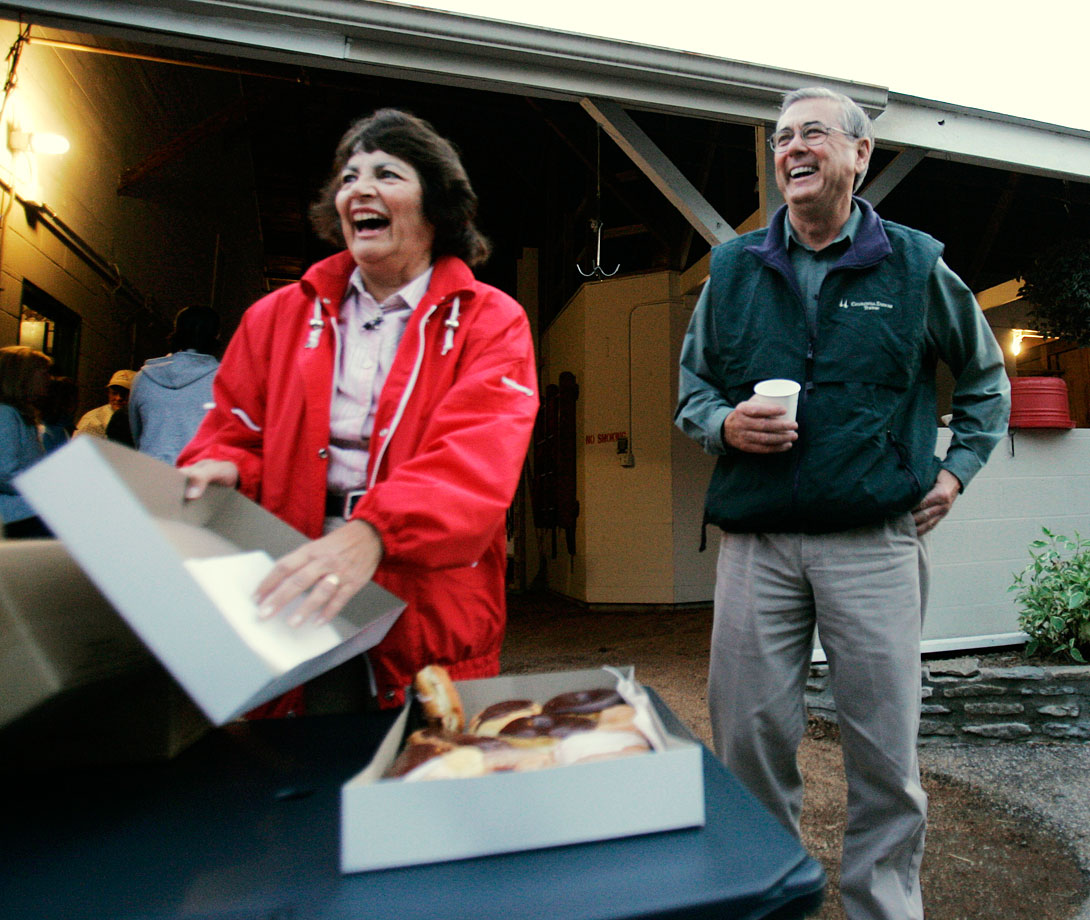 Carl Nafzger, trainer of winning Kentucky Derby horse Street Sense, and his wife Wanda laugh as they offer a box of doughnuts and hot coffee outside his stable at Churchill Downs on May 6, 2007 in Louisville, Ky.