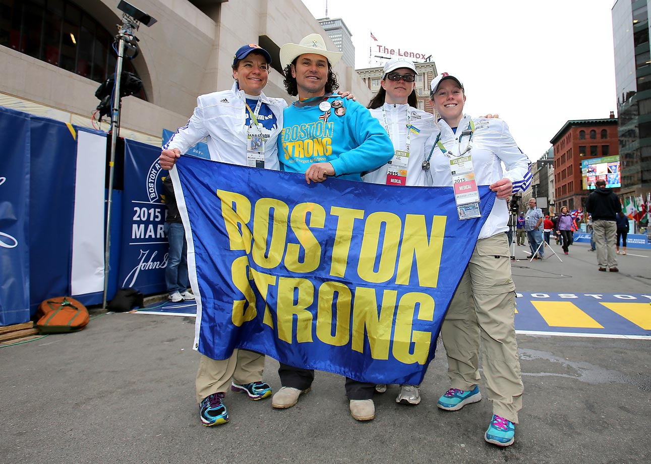 First responder Carlos Arredondo poses at the finish line before the start.