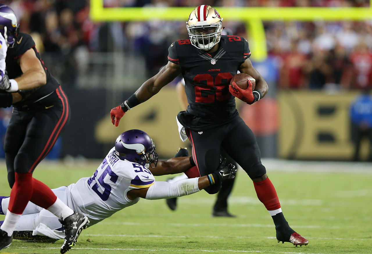 Carlos Hyde of the San Francisco 49ers rushes past Anthony Barr of the Minnesota Vikings.