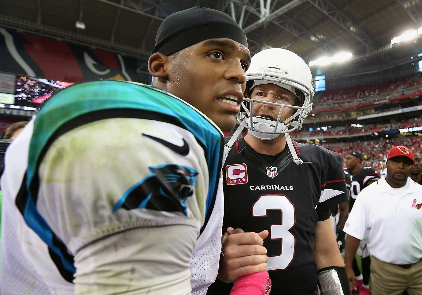 Carson Palmer shakes hands with Cam Newton following their Oct. 6, 2013 game in Glendale, Ariz. Twenty-seven months later they would become the first Heisman-winning quarterbacks to face each other in an NFL playoff game—the 2016 NFC Championship Game.