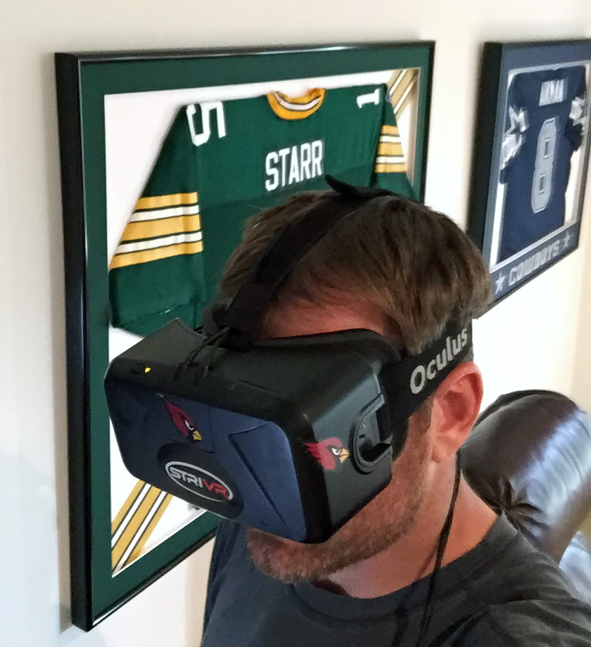 Arizona Cardinals quarterback Carson Palmer uses a virtual reality headset to review formations and scout-team tendencies from practice, and to tweak his own mechanics, on Oct. 30, 2015 at his home in Paradise Valley, Ariz.