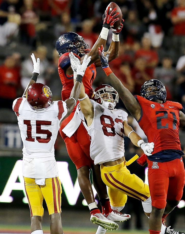 Arizona Wildcats wide receiver Cayleb Jones recovers an onside kick against the USC Trojans. USC defeated Arizona 28-26.