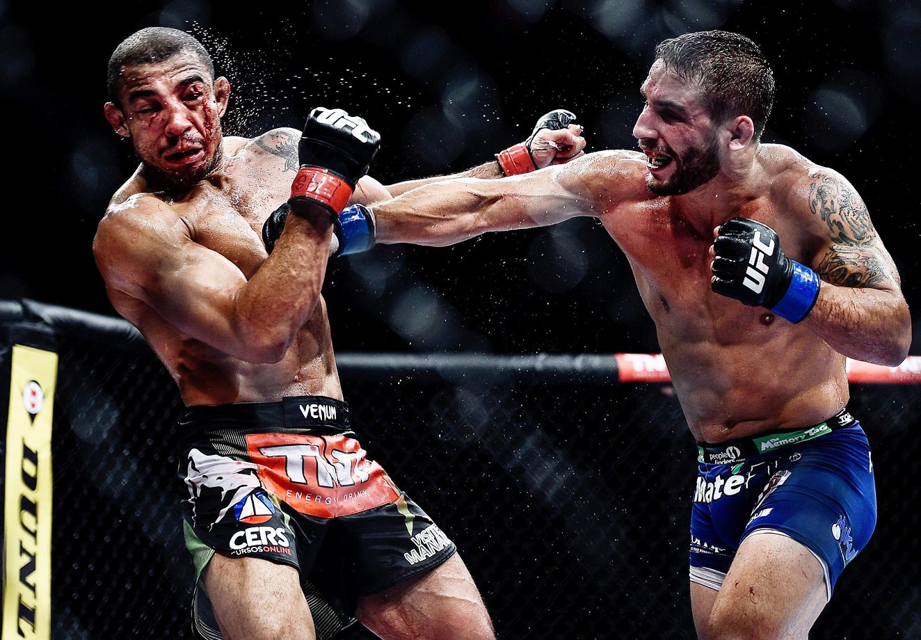Chad Mendes of the U.S. and Jose Aldo of Brazil in their featherweight championship bout during UFC 179 on Saturday.
