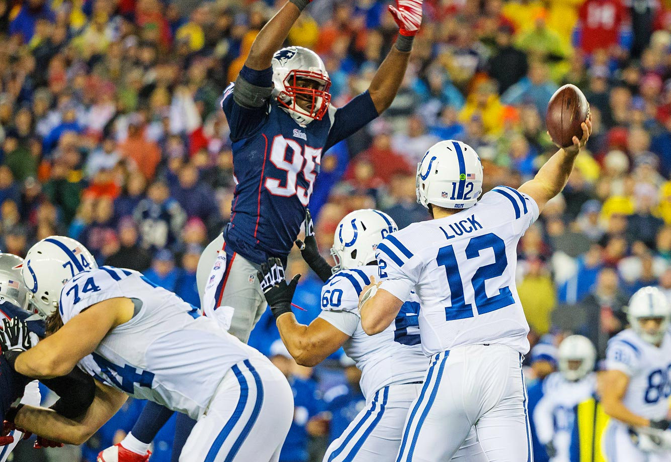 New England Patriots defensive end Chandler Jones (95) tries to bat down a pass from Indianapolis Colts quarterback Andrew Luck (12)                   during the AFC Championship Game at Gillette Stadium.