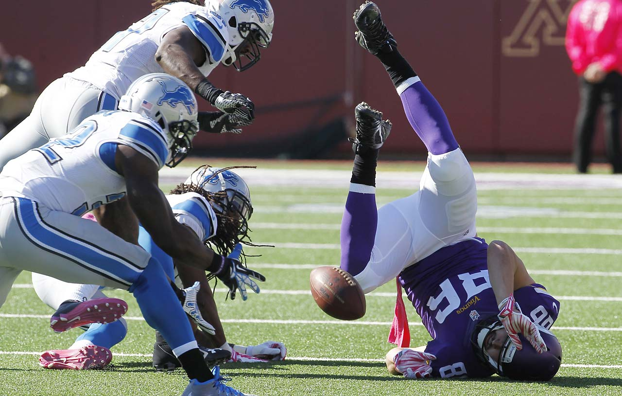 Minnesota Vikings tight end Chase Ford  looses control of the ball as the Detroit Lions defense closes in.