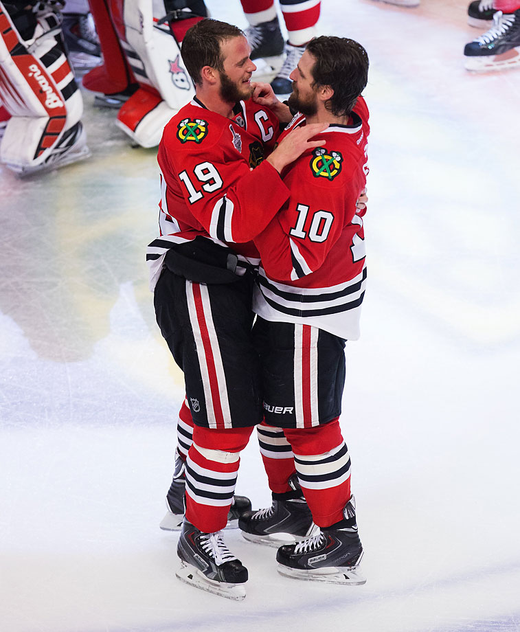 Jonathan Toews (19) and Patrick Sharp enjoy the moment after a grueling season.