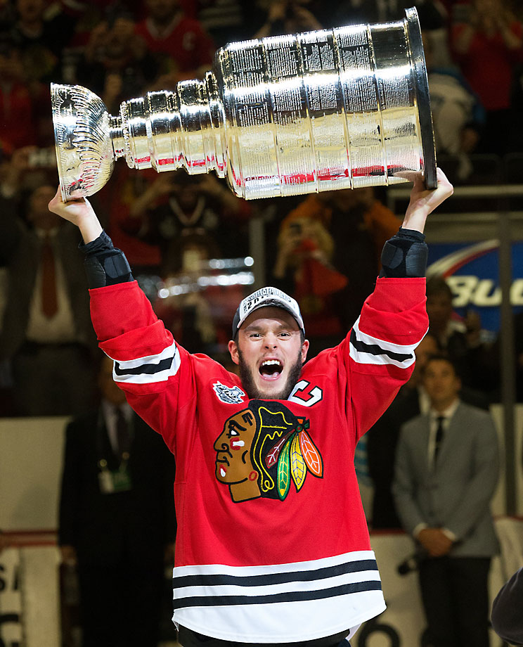 Jonathan Toews  holds the Cup aloft after the Blackhawks clinched the Cup on home ice for the first time since 1938.