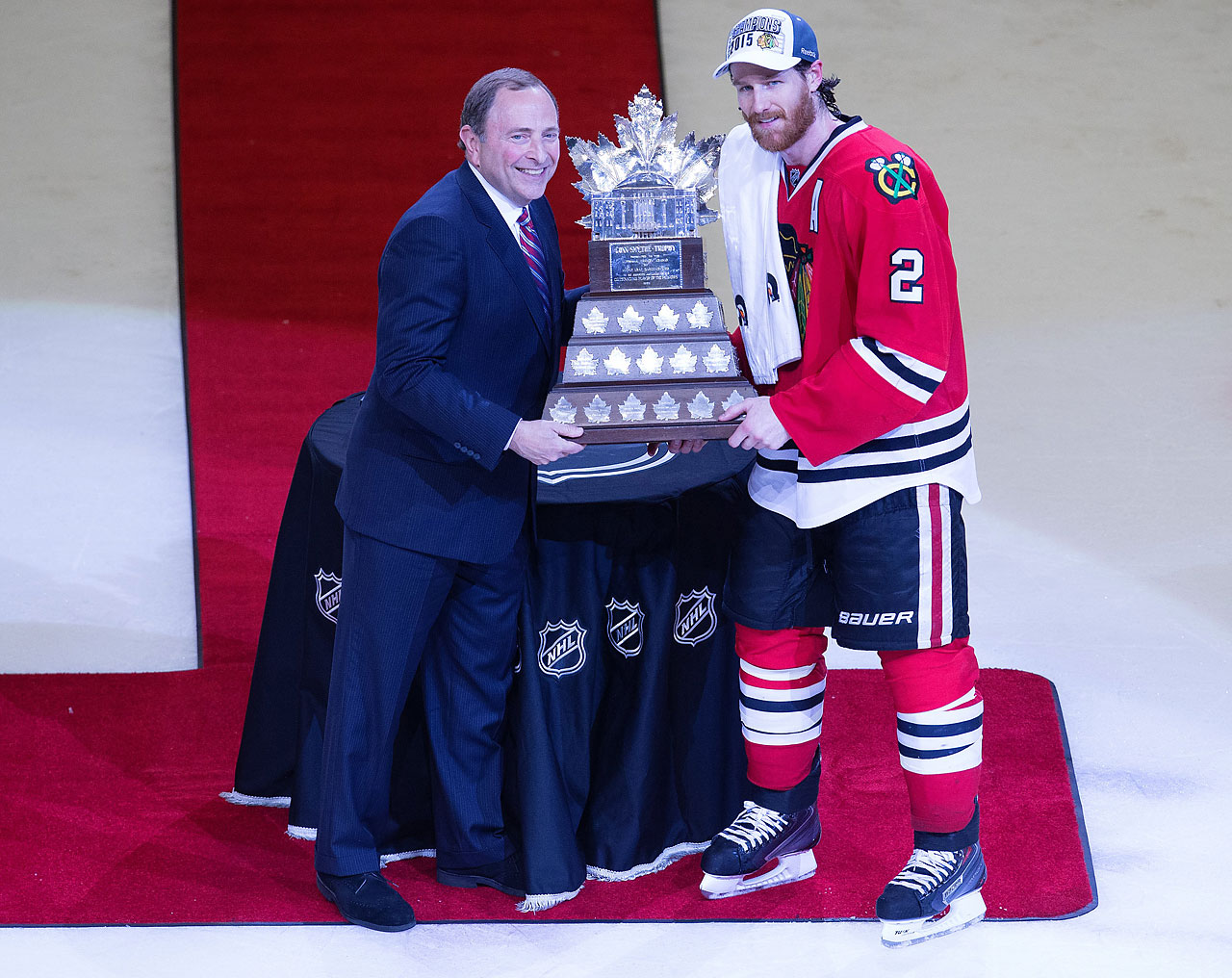 Commissioner Gary Bettman presents the Conn Smythe Trophy to Duncan Keith, who was a unanimous selection for playoff MVP after he finished with 21 points while playing over 700 minutes in the postseason.
