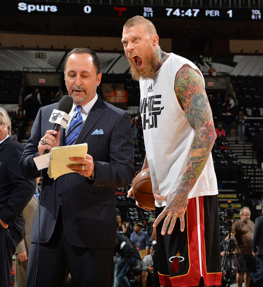 Chris Andersen of the Miami Heat photobombs Eric Reid of NBA TV.