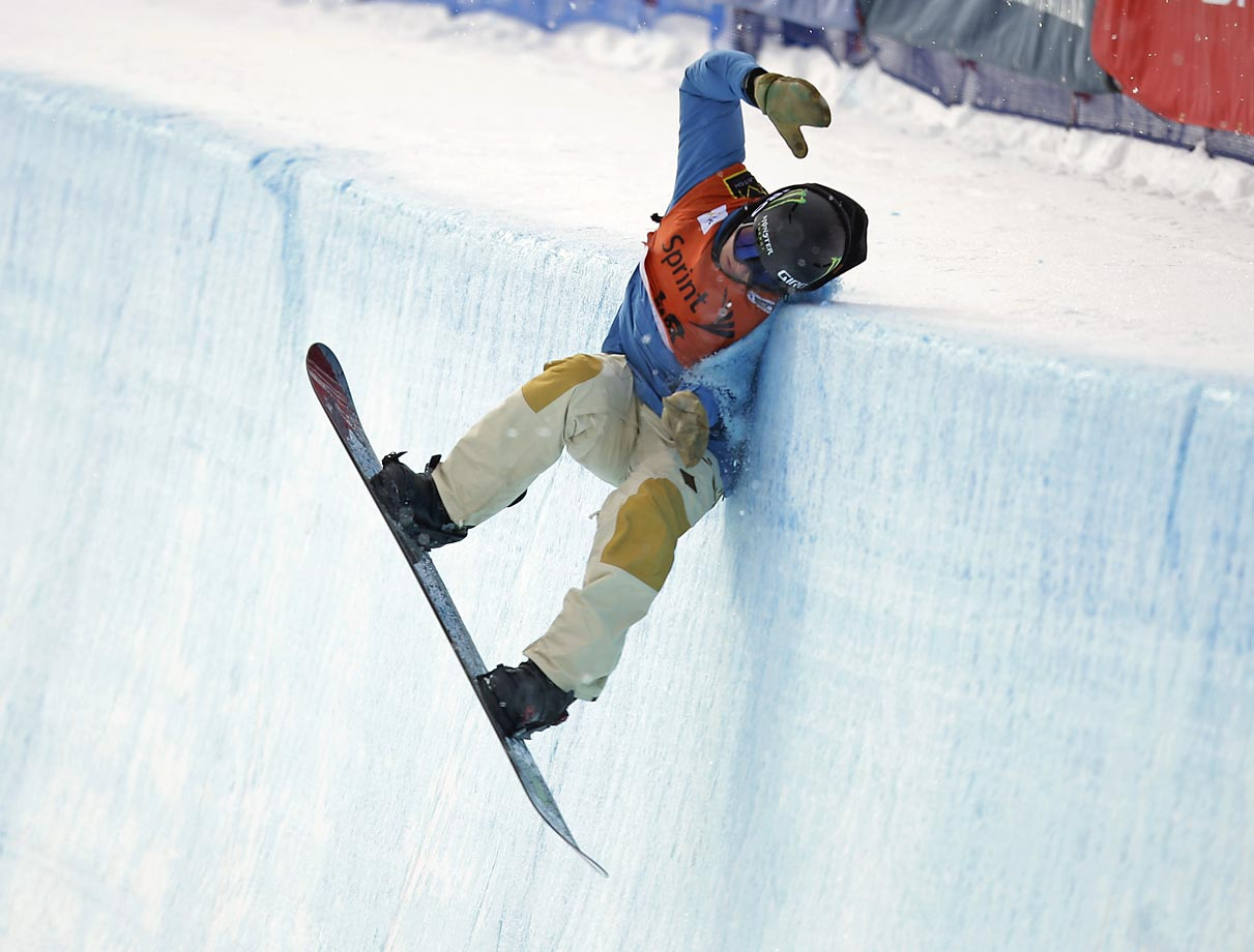 Christian Haller crashes during the World Cup halfpipe snowboard event in Park City, Utah.