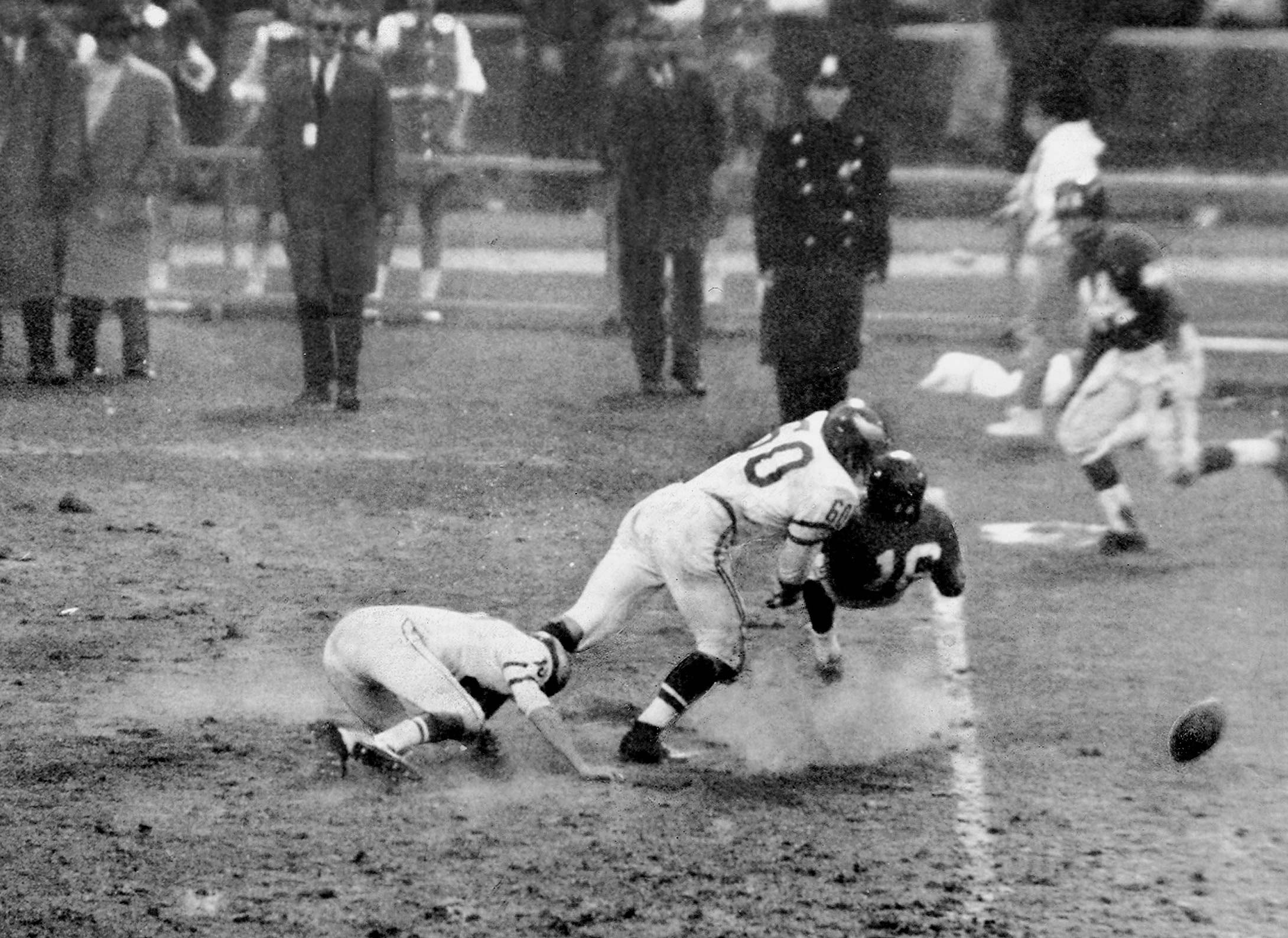 The Ball bounces free as Chuck Bednarik hits New York Giants' Frank Gifford after Gifford caught a pass from George Shaw.