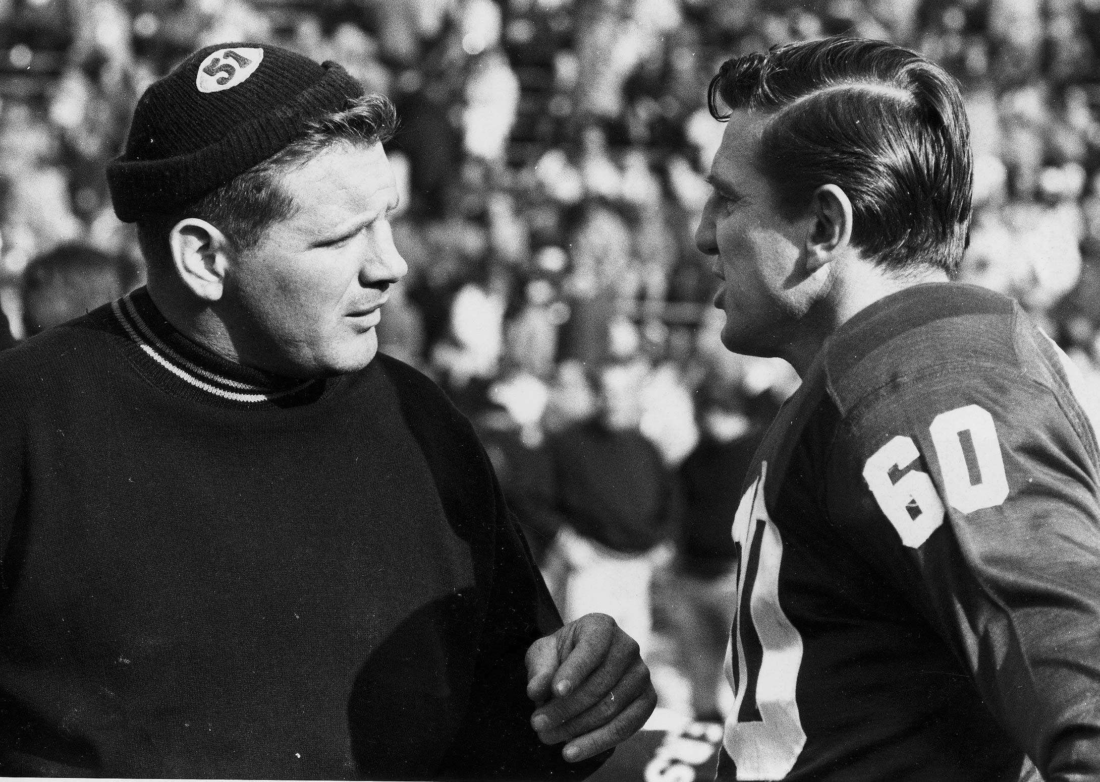 Green Bay Packers blocker Jim Ringo and Chuck Bednarik chat before a 1960 game.
