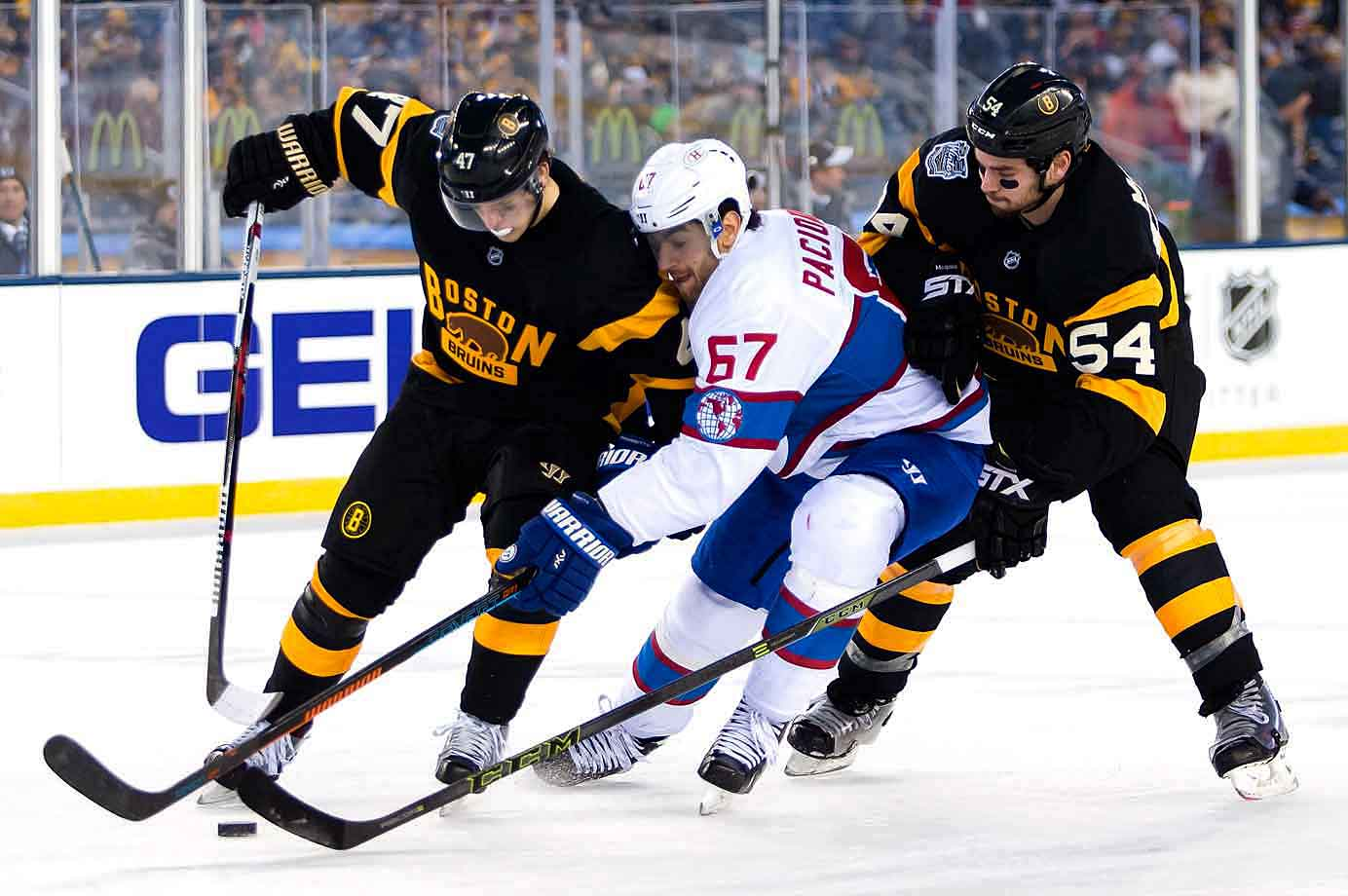 Canadiens captain Max Pacioretty wheedles his way between Boston's Torey Krug and Adam McQuaid.