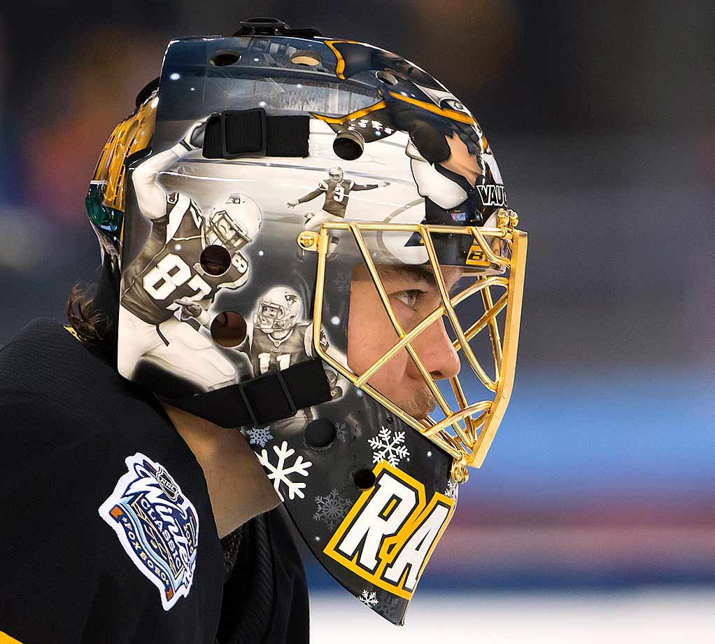 Bruins goaltender Tuukka Rask's special game day mask paid tribute to Patriots coach Bill Belichick and quarterback Tom Brady.