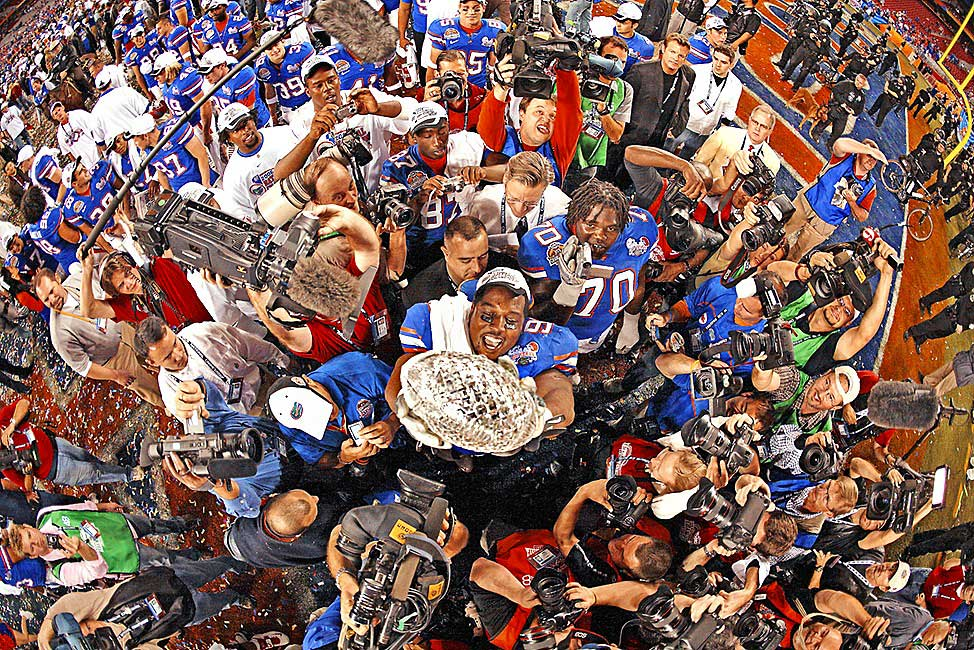 Florida's Steven Harris holds up the trophy after the Gators defeated Ohio State in the 2007 BCS championship game.