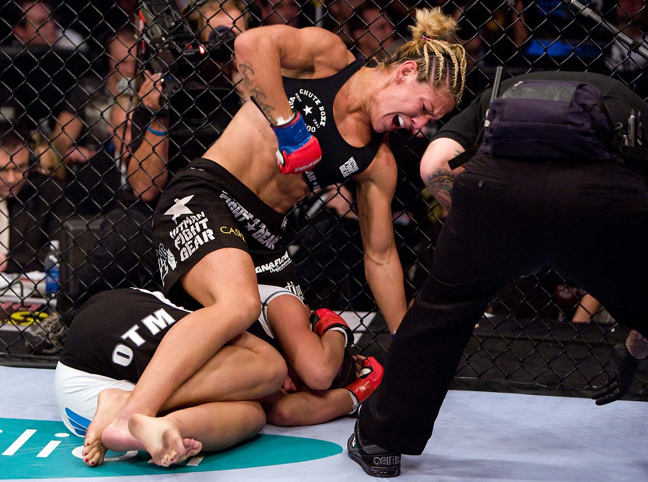 Justino punches Gina Carano during the inaugural Strikeforce women's championship event.