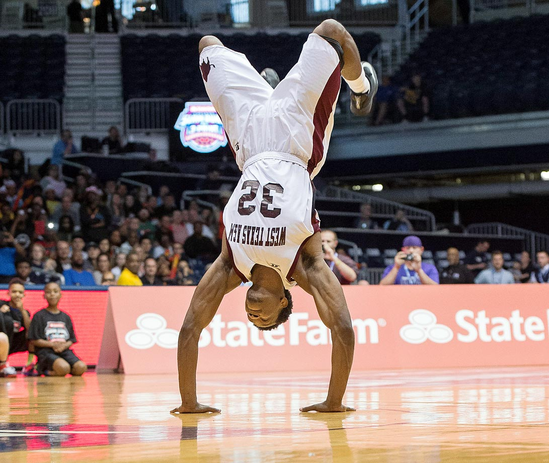 Antjuan Ball of West Texas A&M does a flip before performing his dunk at the State Farm College Slam Dunk & 3-Point Championships in Indiana.