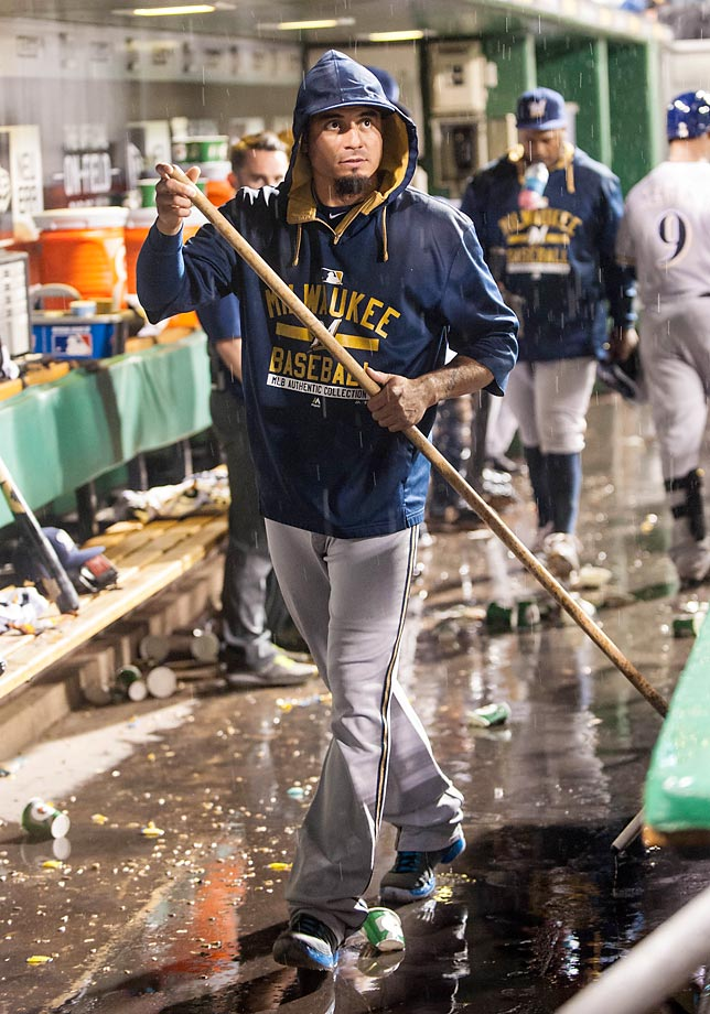 Matt Garza of the Milwaukee Brewers (center) does some in-game mopping during his team's June 8 rainy matchup against the Pittsburgh Pirates in Pittsburgh.