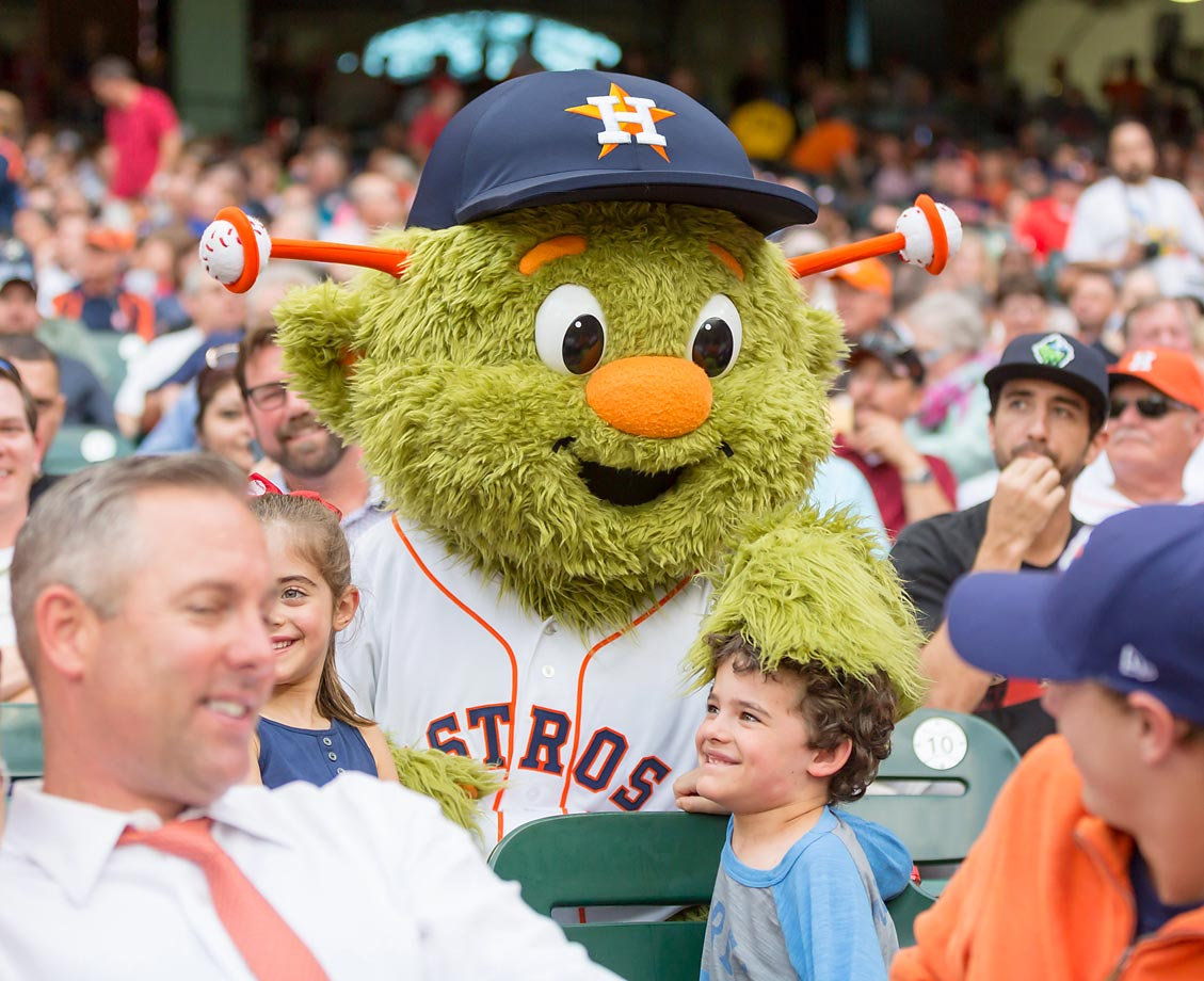 A little duck, duck, goose with a young fan by Houston Astros mascot Orbit during opening day.